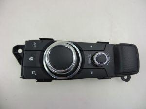 Mazda 2. Navigatie bedienings paneel